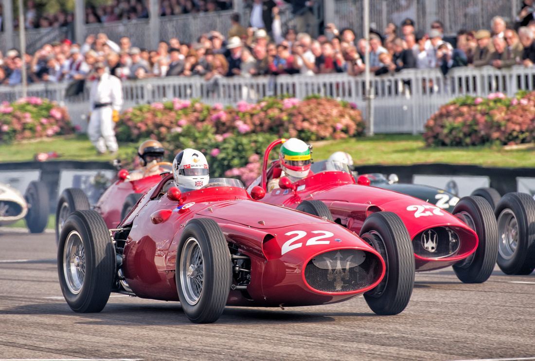 Allan Miles surges ahead of Jose Albuquerque at the start in the Maserati 250F