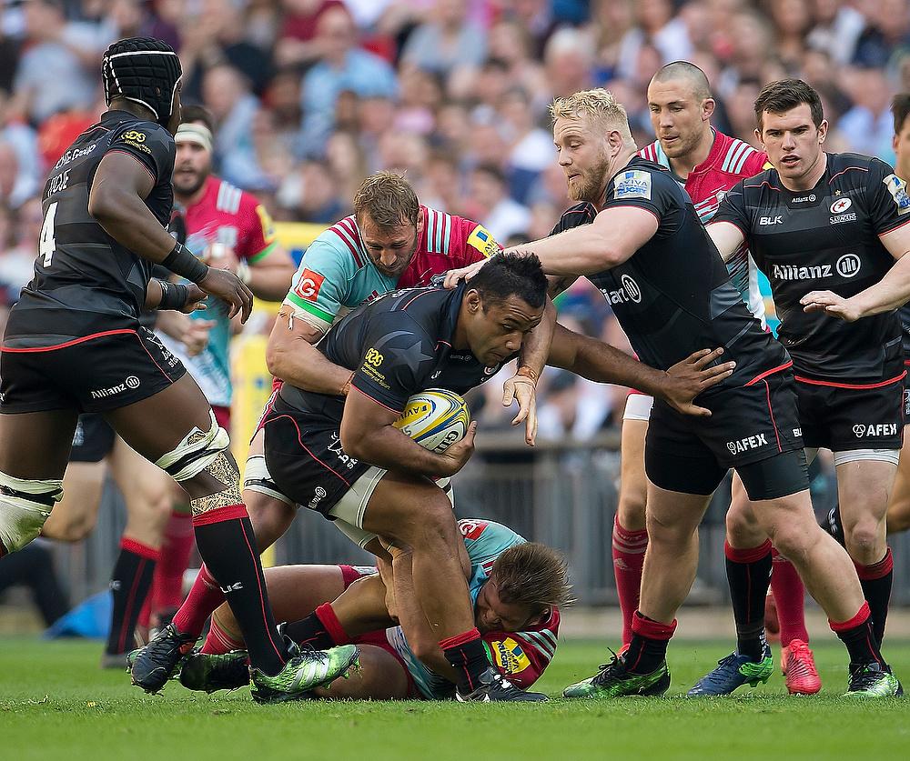 Mako Vunipola escapes the tackle at Saracens v Harlequins rugby match.
