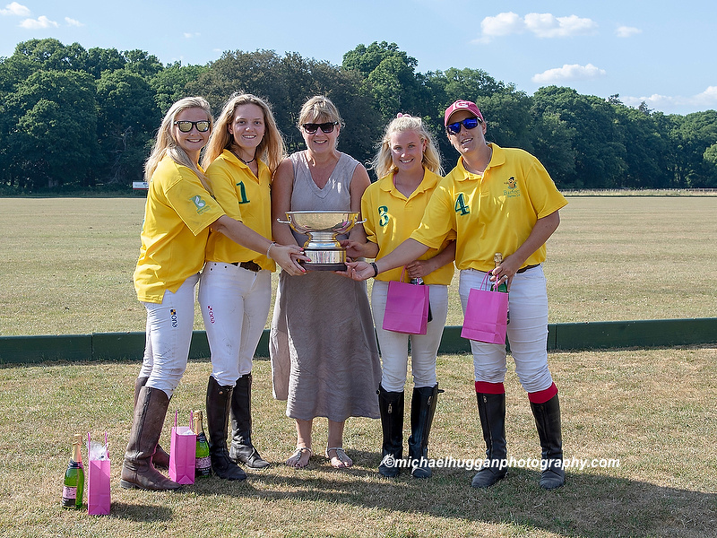 Main Dulce winners of the Women's Festival Cup is presented with the trophy