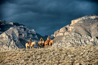 Three Riders high on the ridge against a stormy background