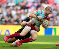Mike Brown of Harlequins is tackled